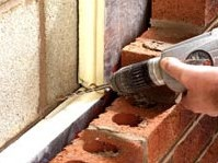 Cavity wall tie installation -  Step 1